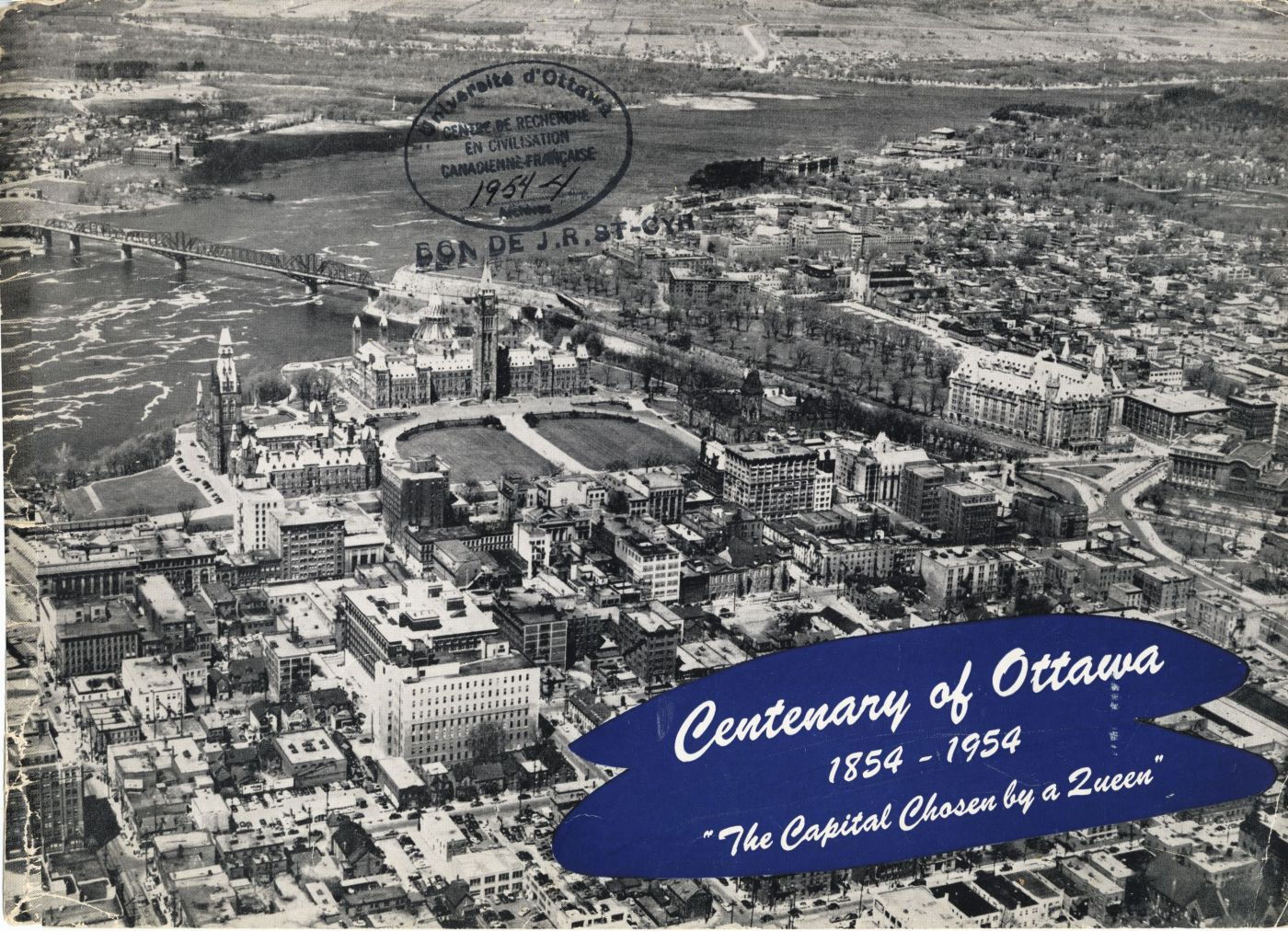 A black and white photograph showing a close-up aerial view of downtown Ottawa with the Parliament Buildings in the Centre. Text typewritten in English.