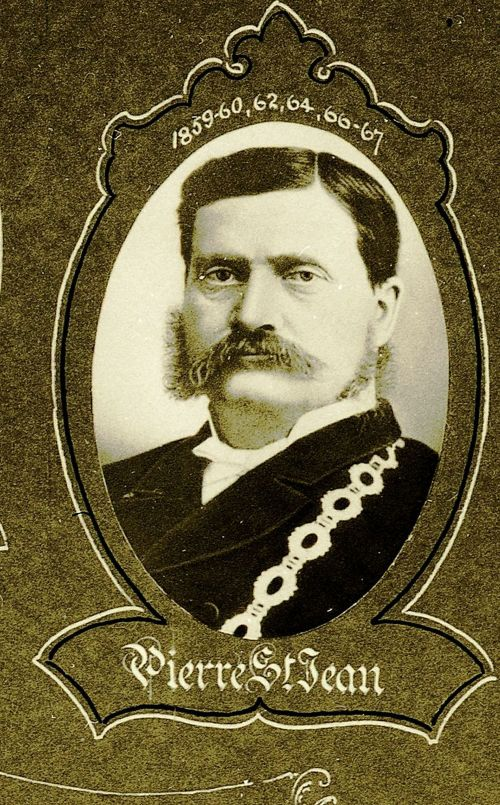 Black and white studio photograph of a man with a mustache, wearing the Mayor's chain of office. The photograph, oval in shape, is surrounded by a decorative frame. Name and dates are indicated.