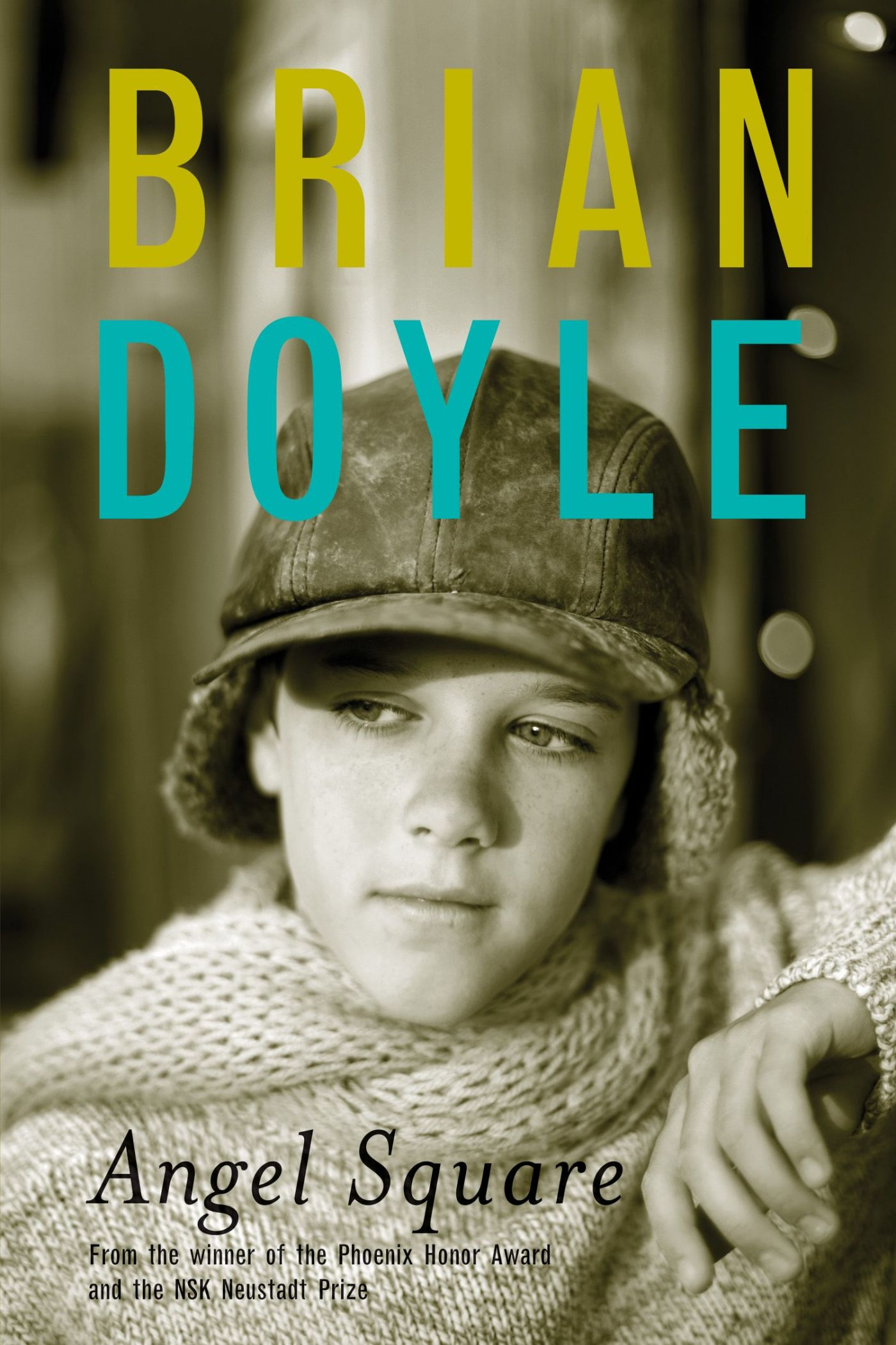 Colour photograph of a young boy wearing a wool cap and sweater, looking thoughtful. Text typewritten in English. The author's name appears in yellow and blue.