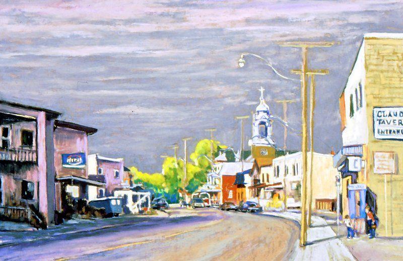 Photographie en couleur d'un tableau représentant la rue principale de ce qui ressemble à un village, où se mélangent commerces et résidences. Deux jeunes discutent sur le trottoir. Le clocher d'une église se démarque du paysage.